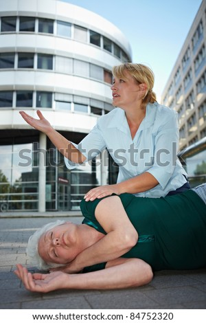Passerby near helpless senior woman pleading for first aid help