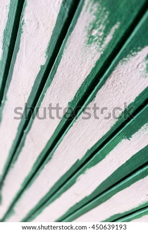 Passing in a diagonal perspective line painted green and white boards with a minimum depth of field
