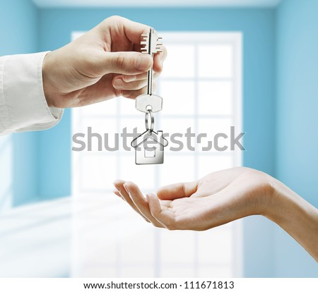 passing key against backdrop of blue room