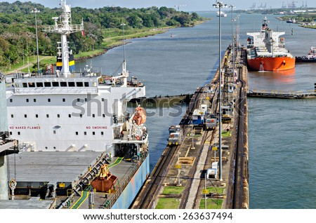 Passing ships in the Panama Canal - stock photo