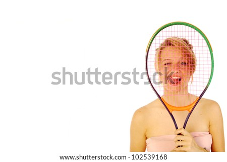Passion for tennis - A young girl with her tennis racket - stock photo