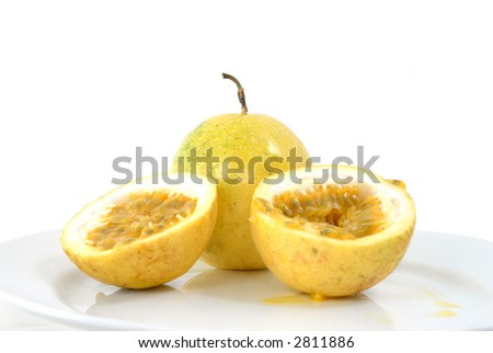 Passion-Fruit on a white plate . - stock photo
