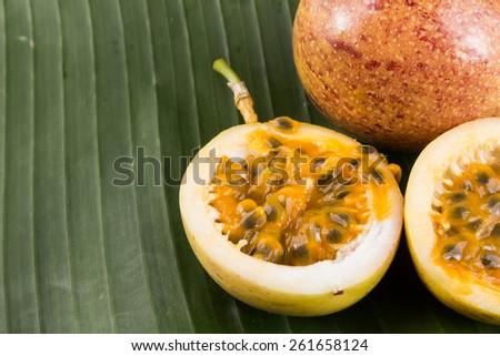 passion fruit on green banana leaf. - stock photo