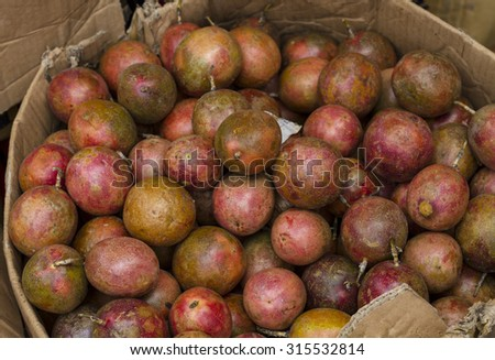 Passion fruits for sale on street in Vietnam - stock photo