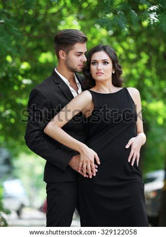 Passion photo of young man and woman on the street - stock photo