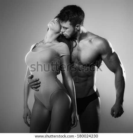 Passion woman and man in the studio - stock photo