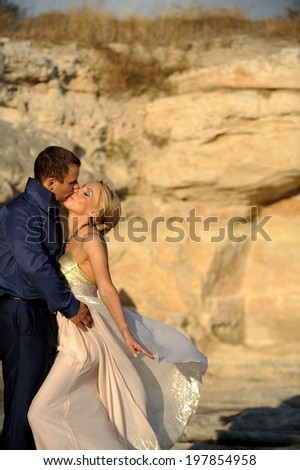 Passionate couple at a beautiful rocky background.  - stock photo