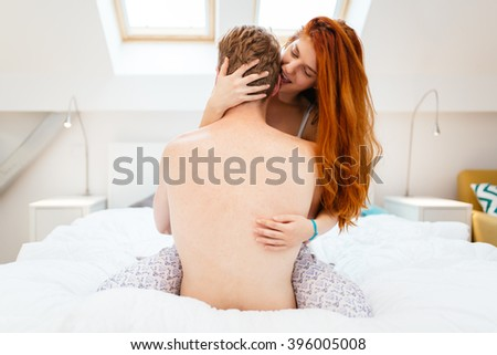 Passionate couple foreplay in bed  with sensuality - stock photo