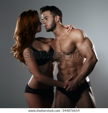 Passionate couple in studio - stock photo