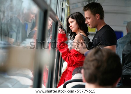 passionate dating a beautiful young couple in the cabin of the bus. - stock photo