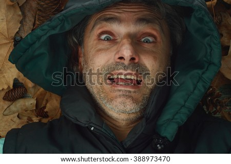 passionate expression middle-aged man wearing a hood, enthusiasm concept