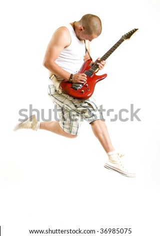 Passionate guitarist jumps isolated on white background