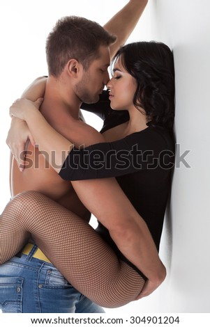 Passionate hugs pair of attractive young people