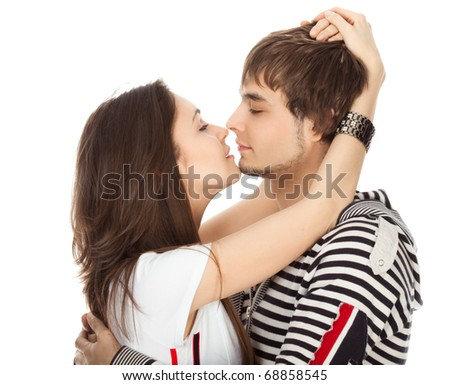 passionate kiss of couples in love isolated on white - stock photo