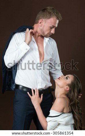 Passionate photo of the girl together with a guy. Studio photography. Attraction.