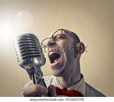 Passionate singer - stock photo