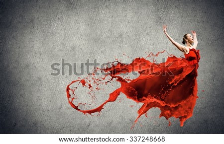 Passionate woman dancer in red dress and red spalshes - stock photo