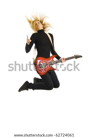 passionate woman guitarist jumps in the air over white - stock photo