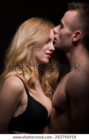 Passionate young couple in a loving embrace