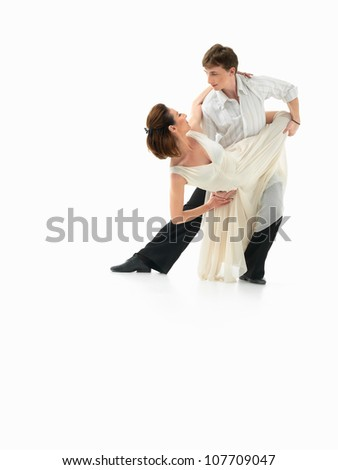 passionate, young couple showing dance moves on white background