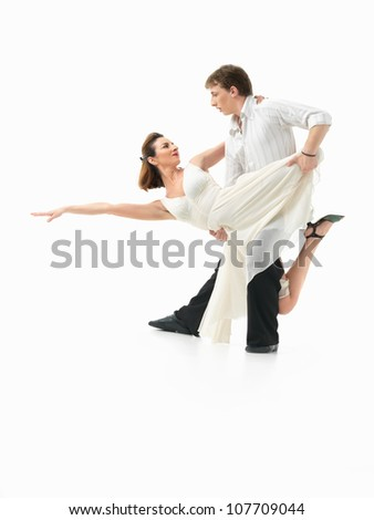 passionate, young couple showing interesting dance moves on white background