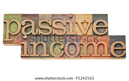 passive income - financial concept - isolated text in vintage wood letterpress printing blocks
