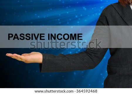 Passive Income on hand business woman - stock photo