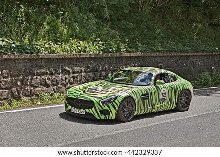 PASSO DELLA FUTA (FI), ITALY - MAY 21: driver and co-driver on a supercar Mercedes-Benz AMG GT-S (2016) green tiger painted in italian rally Mille Miglia on May 21 2016 in Passo della Futa (FI) Italy