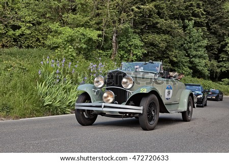 PASSO DELLA FUTA (FI), ITALY - MAY 21: driver and co-driver on an old American car Chrysler 75 (1929) in historical classic race Mille Miglia, on May 21, 2016 in Passo della Futa (FI) Italy