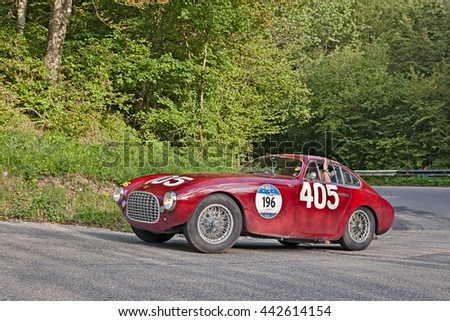 PASSO DELLA FUTA (FI), ITALY - MAY 21: driver and co-driver on the 1951 Mille Miglia winner Ferrari 340 America in historic car race Mille Miglia on May 21, 2016 in Passo della Futa (FI) Italy