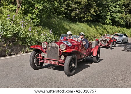 PASSO DELLA FUTA, ITALY - MAY 21: driver and co-driver on an old Italian car Lancia Lambda tipo 221 Spider Casaro (1928) in historic race Mille Miglia, on May 21, 2016 in Passo della Futa (FI) Italy