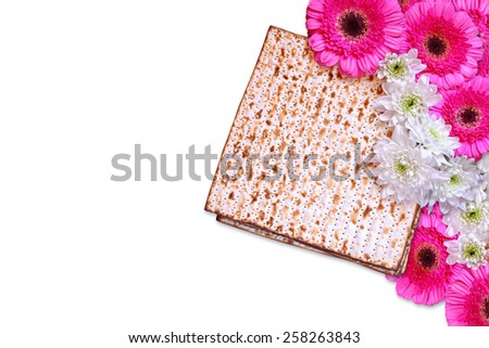 passover background. matzoh (jewish holiday bread) and flowers isolated on white