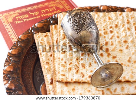 passover background. passover plate wine cup and matzoh (jewish passover bread) over wooden background.  - stock photo
