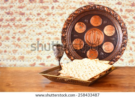 passover background. wine and matzoh (jewish holiday bread) on wooden table
