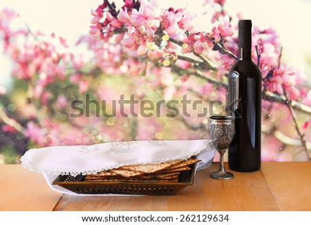 passover background. wine and matzoh (jewish holiday bread) on wooden table  - stock photo