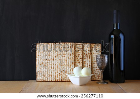 Passover background. wine and matzoh (jewish holiday bread) over wooden board .  - stock photo