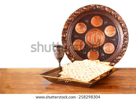 passover background. wine and matzoh (jewish passover bread) on wooden table . isolated on white - stock photo