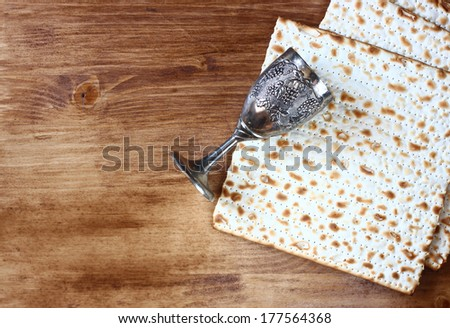 passover background. wine and matzoh (jewish passover bread)  over wooden background.  - stock photo