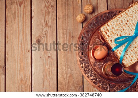 Passover background with matzo and vintage seder plate. View from above - stock photo