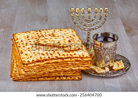 passover matzo with kiddush cup of wine on wooden table