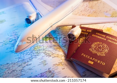 passport, airplane and topography map of Europe  - stock photo