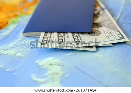 Passport and money on a background map of the world. Traveling concept - stock photo