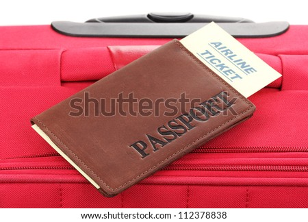 Passport and ticket on suitecase close-up - stock photo