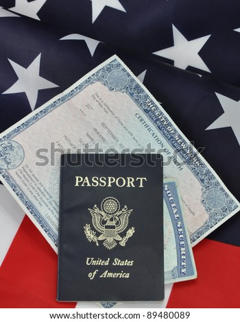 Passport Birth Certificate Social Security Card American Identification Papers on USA Flag - stock photo