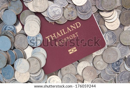 passport book of  thailand with coin money
