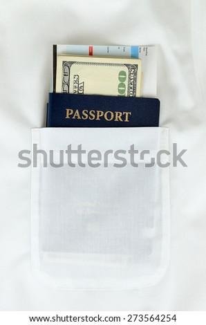 Passport, money and boarding pass in white shirt pocket - vocation set - stock photo