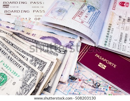 Passport, money, map and boarding pass