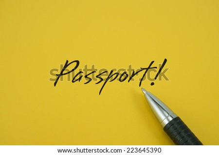 Passport! note with pen on yellow background