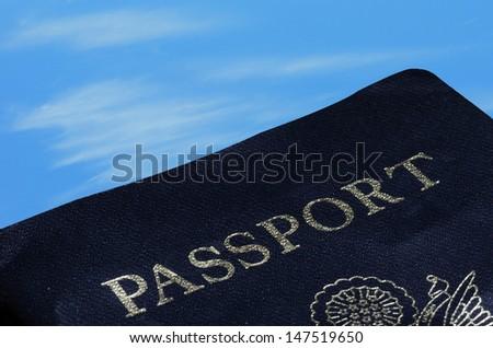 passport on blue sky for international travel concept - stock photo