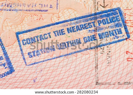 Passport page with Jordan immigration control stamp instructing to contact the nearest police station within one month.  - stock photo
